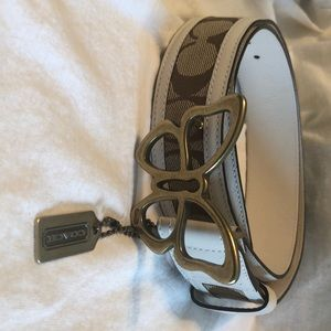 Coach Butterfly belt. White leather trim. Size M